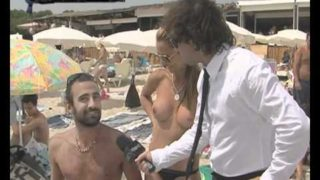 Ibiza beach girl topless interview